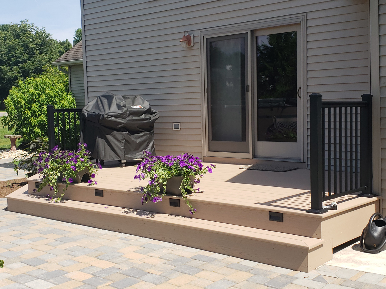 small deck connected to patio